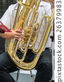 Close up of Hand playing Golden tuba musical instrument, part of classic music band, musical concept 26379983