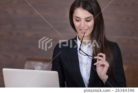 Pretty woman holding documents and glasses in 26384396