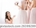 Delighted bridesmaid looking at the bride 26399289