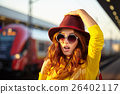 Autumn girl on the go, the situation at the railway station 26402117