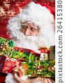 Photo of happy Santa Claus in eyeglasses looking at camera . 26415380