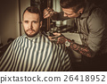 Confident man visiting hairstylist in barber shop. 26418952