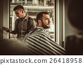 Confident man visiting hairstylist in barber shop. 26418958