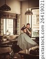 Confident man visiting hairstylist in barber shop. 26419021