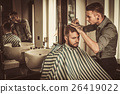 Confident man visiting hairstylist in barber shop. 26419022