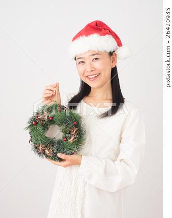 A woman with a Christmas wreath 26420935
