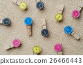 Wooden clothespins on burlap sack background. 26466443