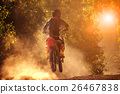 man riding motorcycle in motor cross track  26467838
