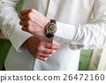 Man arranging his buttonholes 26472160