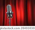 Vintage microphone on stage with red curtain 26493030