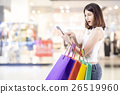 Woman shopping in shopping mall 26519960