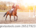 Young rider woman riding horse at the competition 26527923