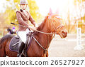 Young rider woman riding horse at the competition 26527927