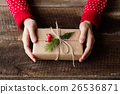 Unrecognizable woman holding Christmas present 26536871