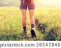 young woman hiker walking on trail in grassland 26547846
