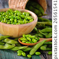 green soy beans in the wood bowl on table 26561541