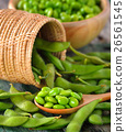green soy beans in the wood bowl on table 26561545