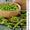 green soy beans in the wood bowl on table 26561598