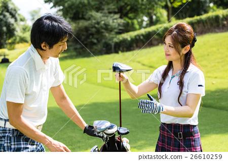 A golfer choosing a golf club 26610259