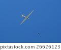 propeller-driven airplane is towing a glider 26626123
