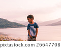 little boy sitting alone at dam in the evening ,vintage tone 26647708