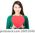 beautiful young woman holding red heart gift box 26653046