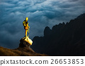 Fantastic sunset in mountains with hiker on a stone where he arr 26653853