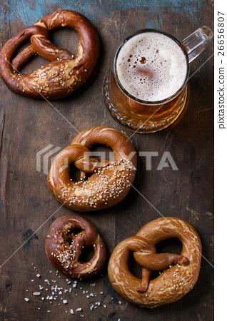 Lager beer with pretzels 26656807