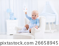 Baby boy with bottle drinking milk or formula 26658945