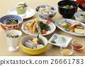 Meal of sushi with tuna, shrimp, tempura on the 26661783
