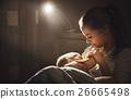 breastfeeding. mother feeding a baby breast in bed dark night 26665498