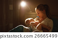 breastfeeding. mother feeding a baby breast in bed dark night 26665499
