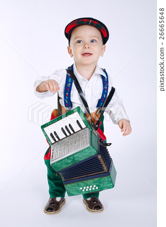 boy with an accordion on white 26665648