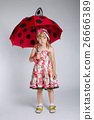 little girl with umbrella on white 26666389