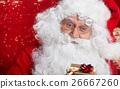 Photo of happy Santa Claus in eyeglasses looking at camera 26667260