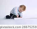 little boy plays with plug 26675259