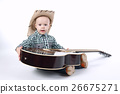 little boy plays guitar on white 26675271