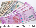 2000 rupee banknote over US dollar banknote. 26682164