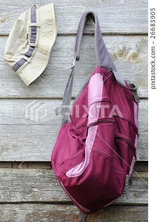 Khaki Hat and Purple Backpack 26683905