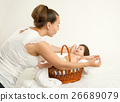 mother talk with baby in basket, yellow toned 26689079