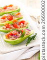 Stuffed avocado on tray. 26690002