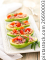 Stuffed avocado on tray. 26690003