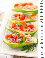 Stuffed avocado on tray. 26690005