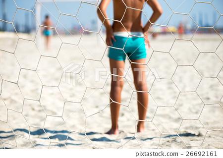 children playing beach soccer 26692161