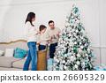 Joyful married couple is celebrating Christmas 26695329
