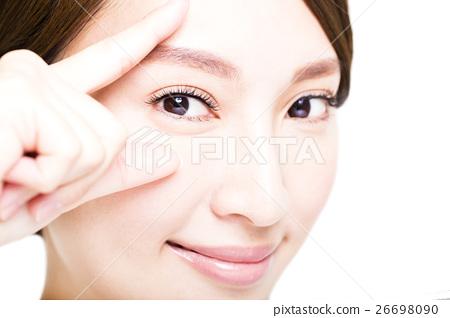 Closeup shot of young smiling woman eyes makeup 26698090