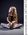 Cute curly-haired little girl posing with ball 26716572