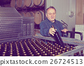Smiling wine maker inspect containers 26724513