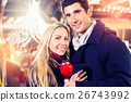 Couple with sweet apple on Christmas market 26743992