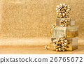 Gifts ribbon bow golden background Holidays deco 26765672